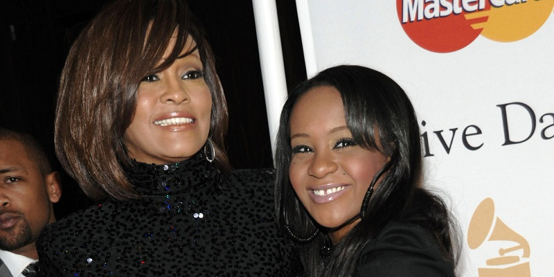FILE - In this Feb. 12, 2011 file photo, singer Whitney Houston, left, and her daughter Bobbi Kristina arrive at the Pre-Grammy Gala & Salute to Industry Icons with Clive Davis honoring David Geffen in Beverly Hills, Calif. Bobbi Kristina Brown has been spotted wearing a sparkly bauble on her ring finger, but she's not planning on getting married anytime soon. A rep for Brown's mother, the late Whitney Houston, says the 19-year-old is ?simply wearing her mother's ring? and that she's not engaged. (AP Photo/Dan Steinberg, file)